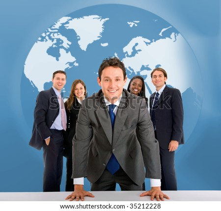 Business team in front of a world map - stock photo