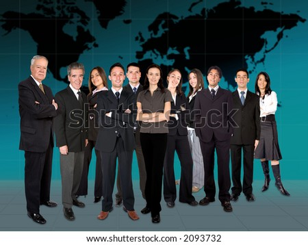 business team in front of a worldmap in the background - stock photo