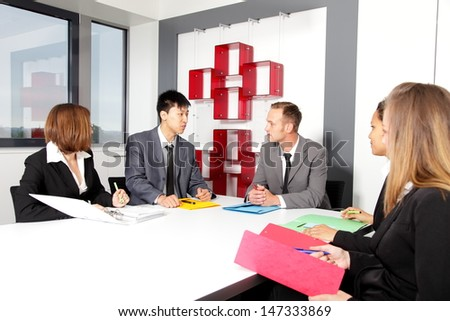 Business team in office at the meeting in conference room - stock photo
