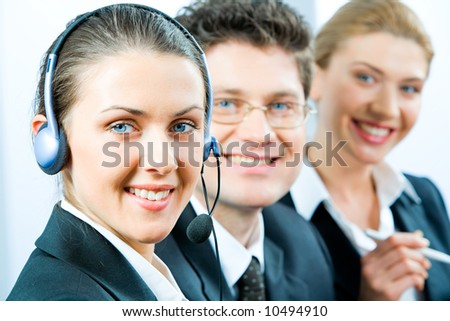 Business team in row with friendly consultant in front - stock photo