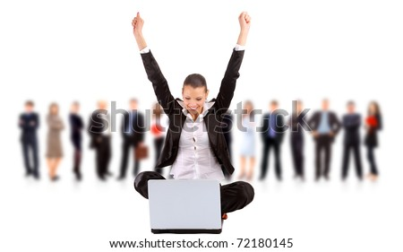 business team in the background with a businesswoman in an office laptop - stock photo