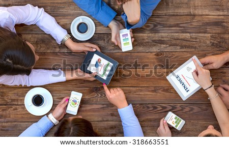 Business Team Interaction  Top View of Arms of Group Young Business People Discussing Data on Electronic Gadgets Related to Marketing and Finance Results - stock photo