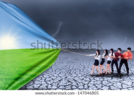 Business team is pulling summer season background to change drought season - stock photo