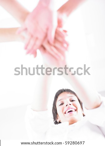 Business team join hands on white background - stock photo