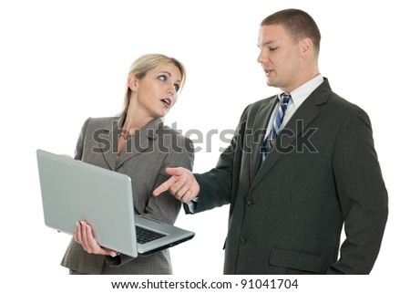 Business team looking at the laptop computer isolated on white - stock photo