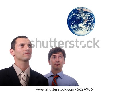 business team looking earth - stock photo