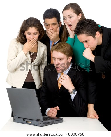 business team looking shocked and worried when looking at the laptop computer on the table - stock photo
