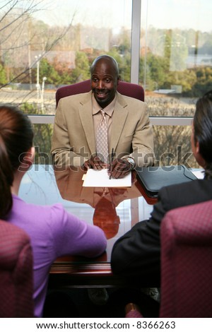 Business team made of men and women in an office - stock photo