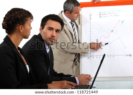 business team making a presentation - stock photo