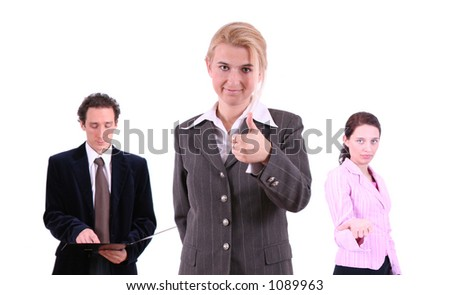 Business team - man and two women. Focus on woman in grey