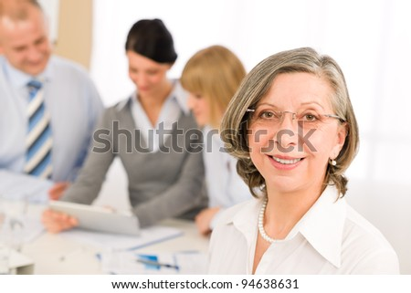 Business team meeting executive senior businesswoman with colleagues - stock photo