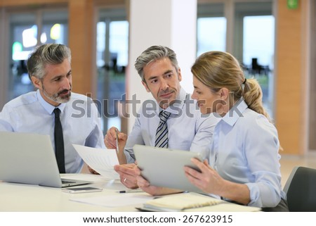 Business team meeting for financial project - stock photo