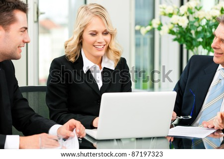 business team meeting in an office with laptop the boss with his employees business nap office relieve