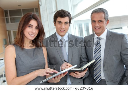 Business team meeting in hall - stock photo
