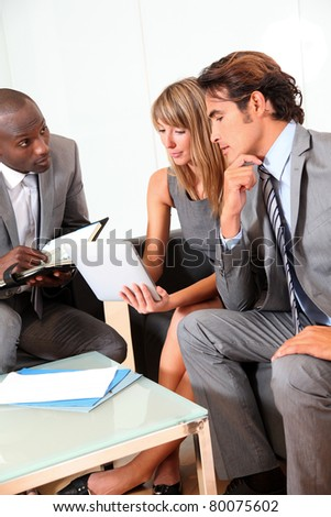 Business team meeting in lounge room - stock photo