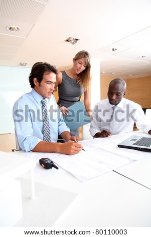 Business team meeting in the office - stock photo