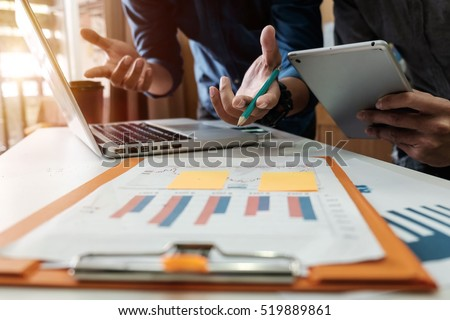 Business team meeting present.professional investor working with new startup project. Finance managers task.Digital tablet laptop computer design smart phone in morning light