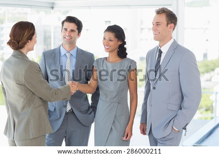 Business team meeting their partner in the office - stock photo