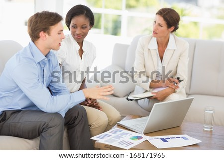 Business team meeting to go over numbers on the couch in the office