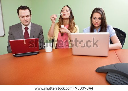 Business team member goofing off - stock photo