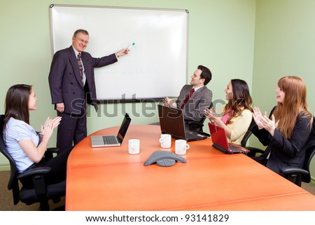 Business team motivated by positive presenter, Clapping employees - stock photo