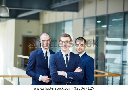 Business team of three men looking at camera - stock photo