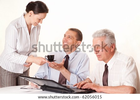 business team of three people on a white background