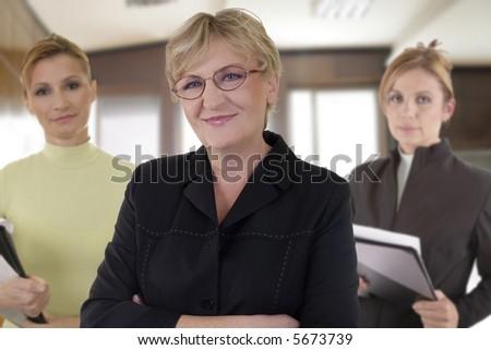 business team of three senior businesswomen at the office - stock photo