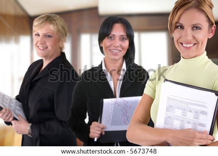 business team of three women at the office - stock photo