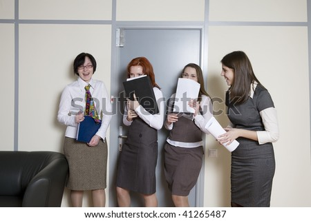 Business team over modern office background. Clerks waiting to give a report