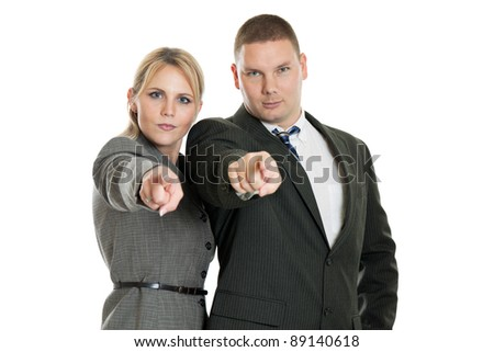 Business team pointing at the camera isolated on white - stock photo