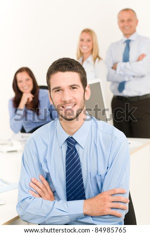 Business team portrait of handsome businessman with attractive happy colleagues