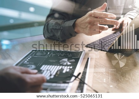 Business team present. professional investor working new start up project. Finance managers meeting.Digital tablet keyboard docking screen computer design smart phone using, sun effect