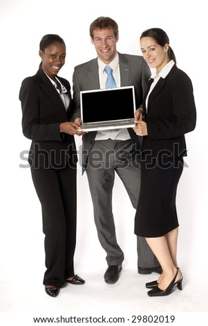 Business team presenting with a laptop - stock photo