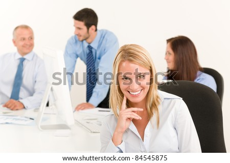 Business team pretty smiling businesswoman portrait happy colleagues around table - stock photo