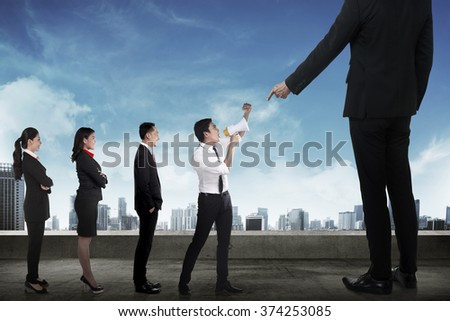 Business team protest to the boss using megaphone. Business communication concept - stock photo