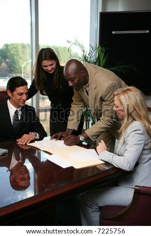 Business team ready to sign a contract in an office - stock photo