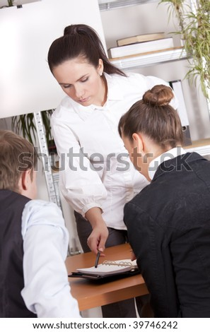 business team receiving corporate training in an office - stock photo
