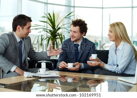 Business team sharing ideas during break - stock photo