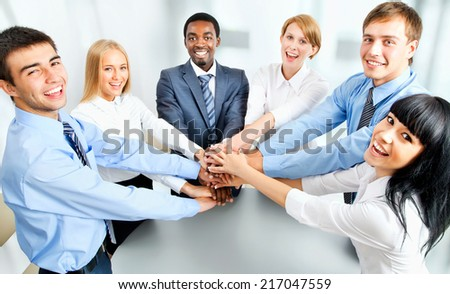 Business team showing unity with their hands together