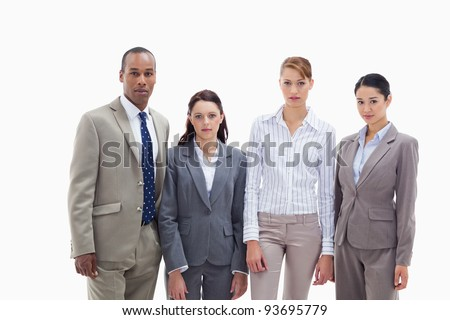 Business team side by side three women and one men against white background