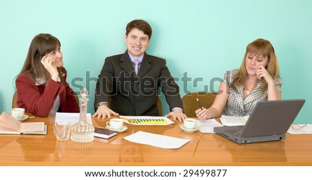 Business team sits at the big table