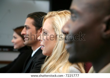 Business team sitting in a meeting at work - stock photo