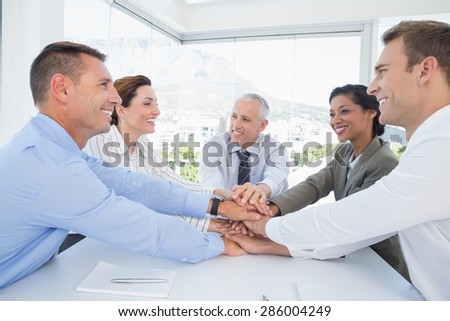 Business team sitting together and celebrating in the office - stock photo