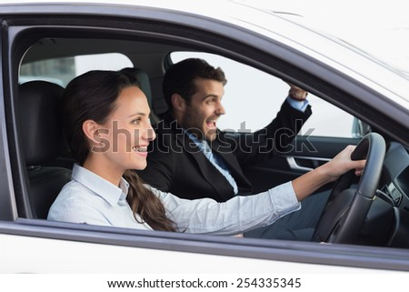 Business team smiling and driving in the car