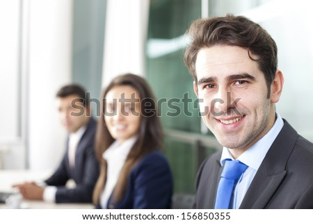 Business team smiling at the office, lined up
