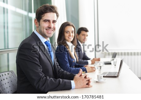 Business team smiling at the office, lined up - stock photo