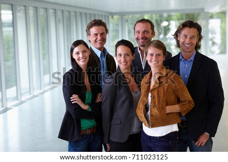 Business team smiling in empty office