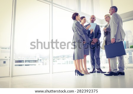 Business team standing and speaking in the office - stock photo