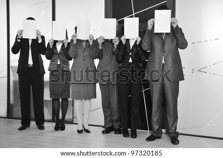 business team standing holding white papers - stock photo